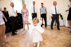 Cute girl dancing with DJ Simon Henderson at Pembroke Lodge Surrey Wedding Photography © Fiona Kelly Photography