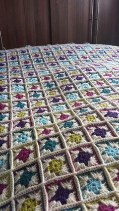 My completed Springtime throw,  from the Nikki Trench pattern. I persevered over 2.5 years! 625 squares in total