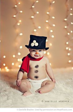 """How cute is this little snowman by Danielle Brasher Photography? Find more Inspiring Christmas Photo Session Ideas via <a href=""""http://iHeartFaces.com"""" rel=""""nofollow"""" target=""""_blank"""">iHeartFaces.com</a>"""