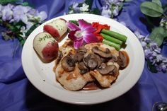 Chicken Marsala - Boneless breast of chicken sauteed with marsala wine demi glace and topped with mushrooms