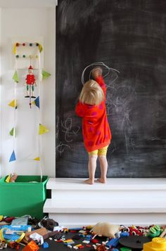 Blackboard wall with little steps (which can also be used to hold larger toys!) Genius!