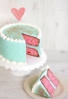 Sea foam green colored cake with pink inside.