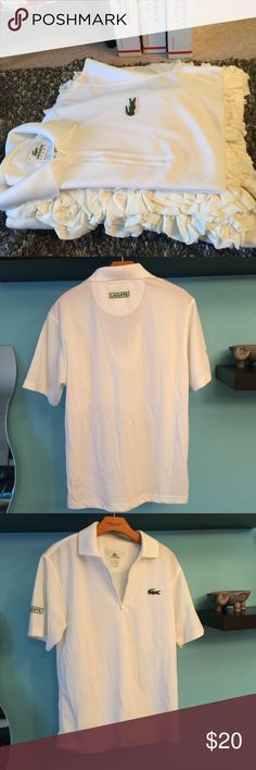 Mens lacoste zip polo Authentic lacoste ( Hubs used to work at the boutique) white NWOT ZIP POLO. has a couple small marks from storage. Very faint tan marks as pictured. Otherwise a super cool top! European size 3 or MEDIUM Lacoste Shirts Polos