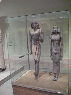 https://flic.kr/p/5h8xuu | Merti and his wife | Merti and His Wife Egypt, Dynasty 5, c. 2350 BC? From Saqqara, SAE Excavations  These tow statues of Merti and his wife are the best preserved of the museum's five examples.  Merti is again stepping forward with his staff and scepter of authority and his wife is standing quietly in repose.  Each is wearing wigs, jewelry and linen garments. The statues are approximately life-size.