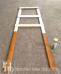 diy ladder for over the toilet storage in the bathroom