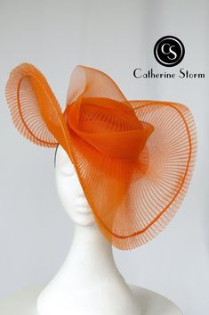 Be bold and dramatic in this eye-catching headpiece. Now available from Catherine Storm Millinery. #bebold #millinery #bespokemillinery #melbournemilliner #fashionsonthefield #orangeheadpiece #orangehat #springcarnival Spring Carnival, Race Wear, Orange Hats, Hat Blocks, Wide-brim Hat, Headpiece, Eye, Fashion, Moda