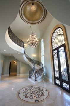 Mediterranean entry and staircase. Do you SEE that staircase? I don't really want or need a 2 story house, but if I could have that staircase, I'd buy it anyway. Style At Home, Future House, My House, Interior And Exterior, Interior Design, Interior Ideas, Entry Way Design, Foyer Design, Window Design