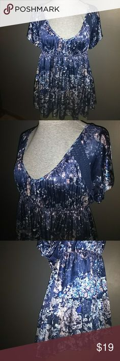 "Free People Floral Shirt Blue polyester with multiple colors floral design has a scoop neck line in front and back and elastic around the waist can be worn off shoulders also if wanted is 29"" long Free People Tops"