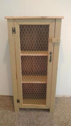This cabinet has a cute farmhouse look to it with the chicken wire door, made out of barn wood painted in an antique yellow/tan color and has 3 shelve. Pallet Kitchen Cabinets, Rustic Cabinets, Diy Cabinets, Kitchen Wood, Pallet Cabinet, Cupboards, Furniture Plans, Rustic Furniture, Diy Furniture