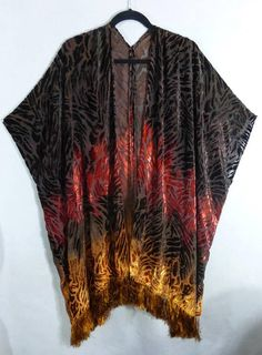 This one-of-a-kind fringed kimono cover-up was hand painted using fiber reactive dyes. The process is similar to painting with watercolors, but then the dyes are steam set to make the dyes permanent and fade resistant. I have painted this piece using bold colors, changing from dark brown to