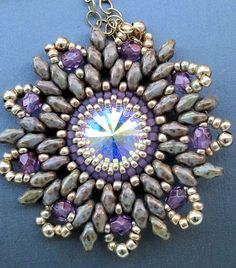 Touches of Amyethest. Swarovski crystal in the middle surrounded by Delicia seed beads and super duo or two-hole czech beads