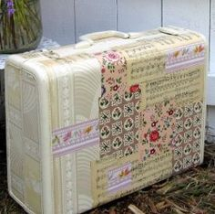 Give an old plastic suitcase a face life!! Fun for a magazine rack or maybe to hold important files