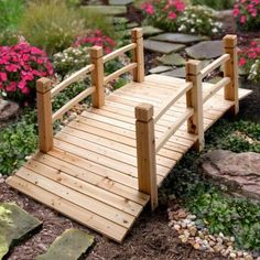 The 5' Wood Plank Garden Bridge is a charming addition to any landscape. This arched wood bridge has 2 side railings.