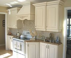French Country Kitchen Cabinet Colors | French country kitchen cabinets in combination with stone countertops ...