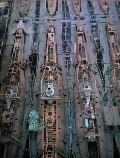 This photo from 1943 shows the mass production of U-boot on a german shipyard. For minimizing the damage caused by aerial attacks, the parts of these submarines were produced in separated and distant places, to be later transported to the shipyards where the submarines could be then quickly assembled and equipped.