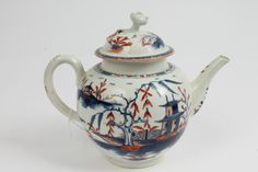 LOT 347  18th century Worcester porcelain teapot and cover with rare brick red and blue 'Candle Fence Pavillion' pattern decoration - underglazed blue crescent mark to base, 19cm CONDITION REPORT Several small rim chips to base of cover collar. Knop re-stuck. The rest in good order
