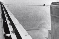 man on wire - Philippe Petit sitting on the wire between the trade centers
