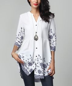 Pretty patterns and a breezy, stretch-enhanced fabric make sure your look stays in the spotlight.Note: This is a one-of-a-kind item; prints may vary.Made for zulilyModel: 5' 8'' tall; 33'' chest; 24'' waist; 35'' hipsSize S: 33'' long from high point of shoulder to hem; 32'' bustTrue to sizeKnit100% polyesterMachine wash; hang dryImported