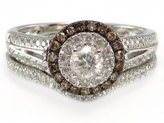 It has a .30 ct round, genuine diamond for a center stone with a halo of .30 ctw of white AND brown (also called chocolate, cognac or champagne) diamonds for accent http://donnatsjewelry.com/Gold-Rings-Bridal/Engagement/Bands/c64_69/p4779/.75-ct-Chocolate/White-Diamond-Engagement-Halo-Wedding-Ring-Set/product_info.html #chocolate diamonds #bridal set #engagement ring #white gold set