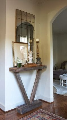 A Slender Console Creates A Ledge For Decorative Items, Which Is A Very  Lovely First