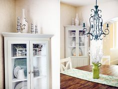 corner cabinet, chandelier, reclaimed dining table
