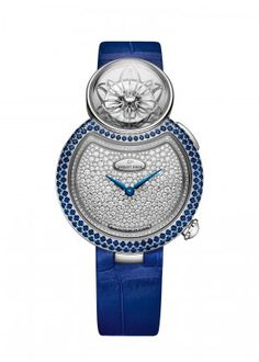 Lady 8 Flower | 18-karat white gold dial set with 353 diamonds, total of 1.38 carats. 18-karat white gold case and applied ring set with 114 blue sapphires and 88 diamonds, buckle set with 47 diamonds, total of 1.61 carats (sapphires) and 0.64 carat (diamonds). Mechanical opening flower automaton movement. 18-karat white gold skeleton petals. Diamond briolette, total of 0.24 carat. Self-winding mechanical hours and minutes movement. Power reserve of 38 h