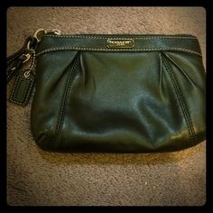 Black Leather Wristlet Coach Wristlet no tears, rips or stains. Looks brand new, 100% authentic. AMAZING deal for an authentic, trendy, matches anything and like new Wristlet!! :) wish I used it more but I'm more of a big bag girl! ALL orders come with a free gift!! Coach Bags Clutches & Wristlets