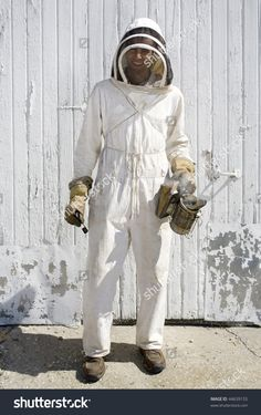 stock-photo-a-beekeeper-dressed-in-full-protective-clothing-44639155.jpg 1,005×1,600 pixels