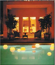 Hollow Candle Collection floating in the pool at night - European Favors