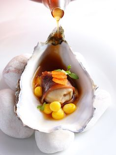Terre et Mer . #Huitre,queue de boeuf consommé.. Longue de boeuf Wagyu .. Lightly poached #oyster, Chinese licorice, root #oxtail consommé, #kimchi pickled daikon, sweetcorn kernels, braised #wagyu beef tongue slice..