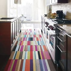 Cheer up a kitchen with brightly striped carpet tiles