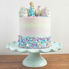 """50 Drool-Worthy Frozen-Inspired Cakes That Look Too Good to Eat For Frozen-loving kids, going """"Into the Unknown"""" of a new age means a birthday celebration with friends and family that includes a delicious cake, Bolo Frozen, Disney Frozen Cake, Disney Frozen Birthday, Frozen 2, Elsa Birthday Cake, Second Birthday Cakes, Frozen Themed Birthday Party, Birthday Parties, Birthday Celebration"""