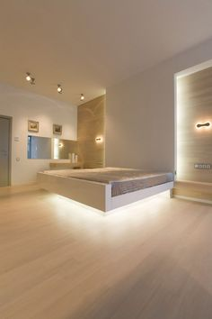 9 Examples Of Beds With Hidden Lighting Underneath // The setback frame under this bed would already make it look like it's floating, but the added lights make it way more dramatic.