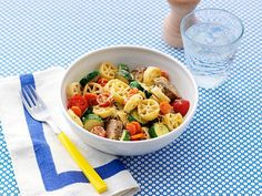 Veggies and sausage are cut into rounds and tossed with wheel-shaped rotelle pasta in Giada De Laurentiis' fun Round and Round Pasta dish.