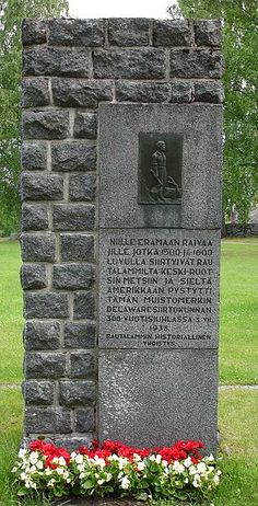 Memorial stone by Rautalampi church to commemorate the emigration to Sweden and Delaware.