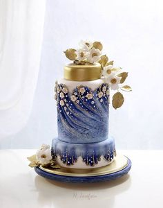 Blue and gold metallic wedding cake