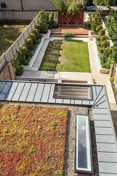 """Renovation and extension to Victorian townhouse in Oxford. Providing a pleasant outlook from the rear of the existing house the extension features a landscaped, """"green"""" roof surrounded by large rooflights and zinc eaves. Portland Stone is used to clad the extension in order to create a visual reference between the addition and the historic stone detailing of the house."""