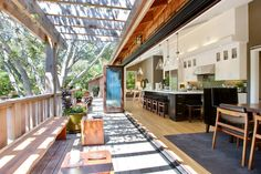 beautiful kitchen that completely opens up to the outside luv the Green tiles