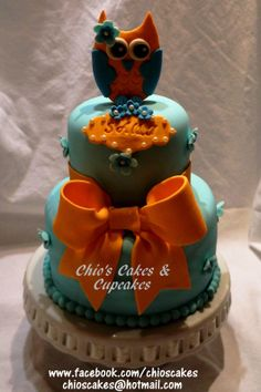 ORANGE & LIGHT BLUE OWL CAKE  I did this very cute and little cake for my girl turning 11 years old. Follow me on www.facebook.com/chioscakes