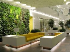 A living wall, or vertical garden, is a selection of wall-mounted plants. Vertical wall gardens are the newest trend in home design and are the perfect way to bring a little bit of the outdoors in. Hotel Lobby Design, Lobby Do Hotel, Office Lobby, Design Entrée, Home Design, Wall Design, Home Interior Design, Design Ideas, Design Room
