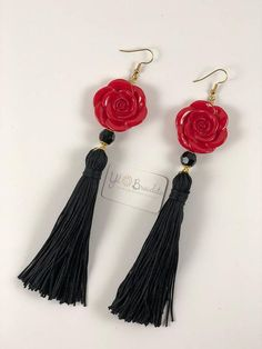 "Beautiful earring insipred in Spain. Handmade 3.75"" black tassel with a 1"" red rose. Total earring length is 6 inches. This earring is a one time only piece."
