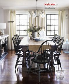 draw attention to the windows/view by painting the woodwork dark instead of white.