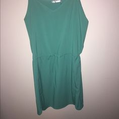 NWT - Mini Dress - Green Perfect for spring! Green mini dress with cinch tie waist. Still has the tags on. Never been worn! Spaghetti strap top! Francesca's Collections Dresses Mini