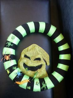 Oogie Boogie burlap with bugs wreath from The Nightmare Before Christmas by HalloQween Creations on Facebook and Etsy. :)