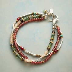 WILDWOOD BRACELET -- Our triple-strand bracelet takes on the colors of…