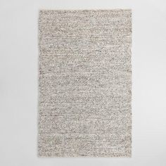 Our handwoven wool rug boasts a plush underfoot feel with a chunky texture inspired by the inviting warmth of your favorite knit sweater. Its speckled gray tone is achieved through a blend of weaving patterns, making it an eye-catching addition to any room.