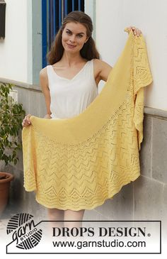 Majesty / DROPS 187-23 - Knitted shawl with lace pattern, wave pattern and garter stitch. Piece is knitted in DROPS Merino Extra Fine.