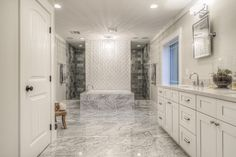 lavish bathroom with white vanity