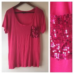 🔴 Express Hot Pink Sparkle Top! Hot pink top with sparkly pocket! Sequins all in tact and in good condition! The shirt itself is a thinner material and has some wear/pilling. NO TRADES. Express Tops