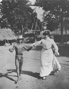 Mrs Wilkins teaching an Igorot boy the Cake Walk.  1904.